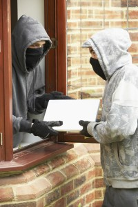 Young Men Breaking Into House