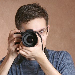 photographer, young man with professional camera